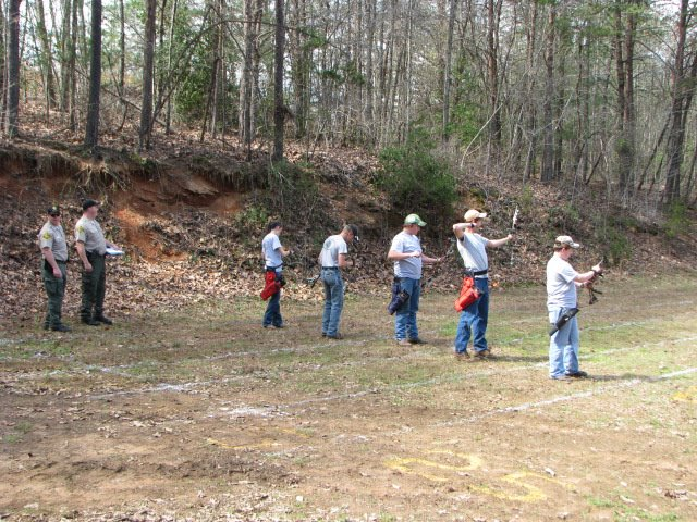 Picture of Yancey Longshots members practicing their archery skills