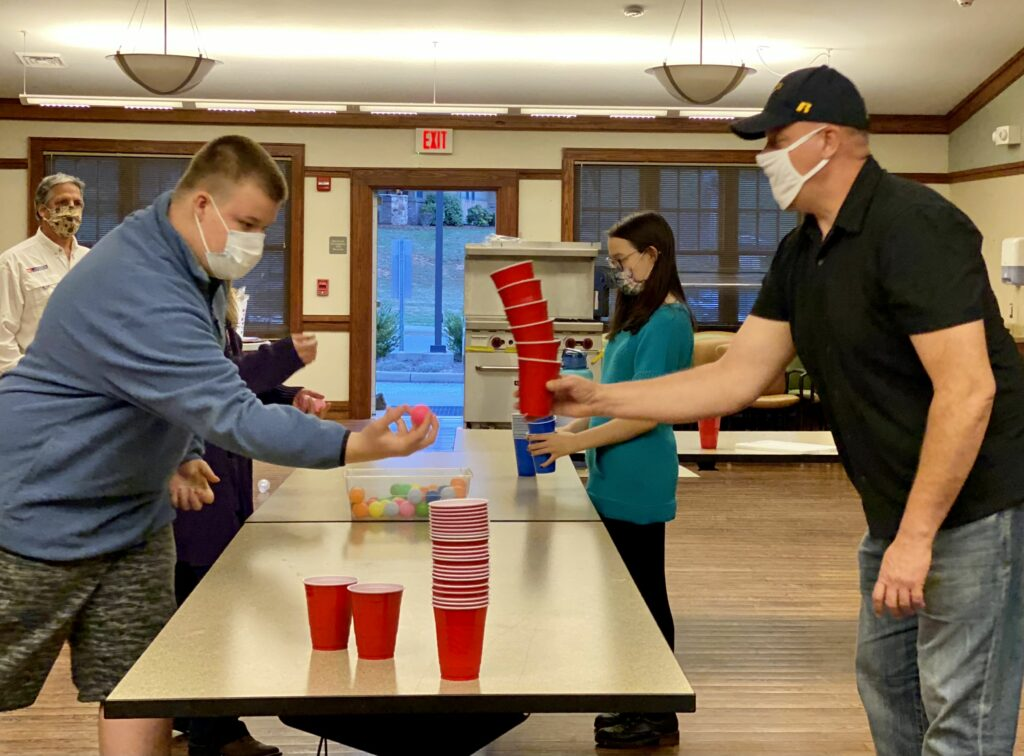 Families stacking balls and cups